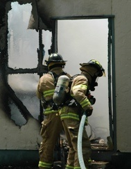 FF's fighting fire in doorway